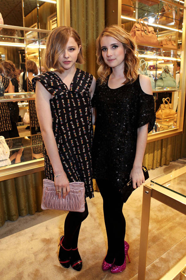 Chloe Moretz (L) and Emma Roberts attend the launch of fashion brand Miu Miu