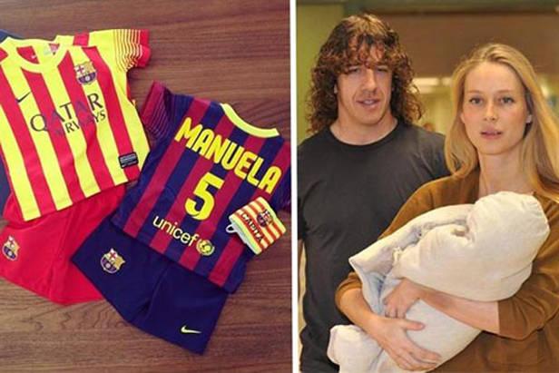 Vanesa Lorenzo y Carles Puyol con su hija Manuela