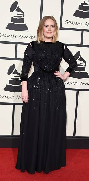 Singer Adele arrives on the red carpet during the 58th Annual Grammy Music Awards in Los Angeles February 15, 2016. AFP PHOTO/ Valerie MACON / AFP / VALERIE MACON (Photo credit should read VALERIE MACON/AFP/Getty Images)