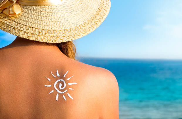 girl using sunscreen to safe her skin healthy, sun tanning, skin care and protection, vacation